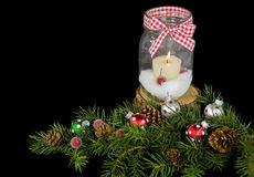 Christmas candle in mason jar Stock Images