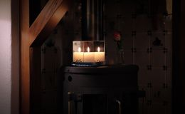 Christmas candle between mirrors stock photo