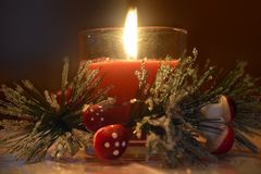 Christmas candle and mushrooms Royalty Free Stock Photography