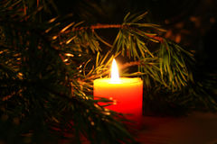 Christmas candle with New Year`s tree brunch on dark background. Conceptual image for celebration greeting card copyspace, place for text and logo Stock Photos