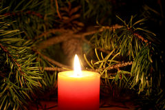 Christmas candle with New Year`s tree brunch on dark background. Conceptual image for celebration greeting card copyspace, place for text and logo Royalty Free Stock Photography
