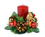 Christmas candle ornament on white background. Christmas ornament with red candle, pine cones, apples and little gift box Stock Images