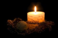 Christmas candle and ornaments Royalty Free Stock Image