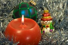 Christmas candle with ornaments. On silver background Royalty Free Stock Photography