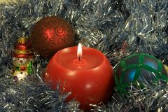 Christmas candle with ornaments. On silver background Stock Photography