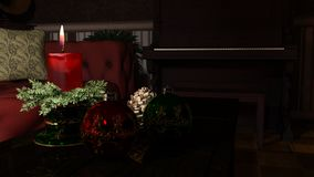 Christmas candle and ornaments over indoor dark background stock images