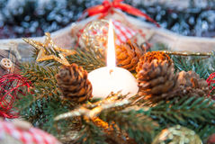 Christmas candle and ornaments Stock Photography