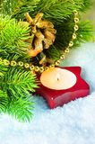 Christmas candle with pine branches Stock Photos