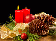 Christmas candle with pine cone Stock Image