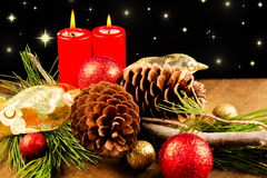 Christmas candle with pine cone Stock Images