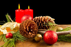 Christmas candle with pine cone Royalty Free Stock Photos
