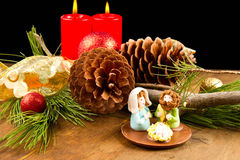 Christmas candle with pine cone Stock Photos