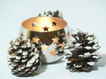 Christmas candle and pine cones Stock Images