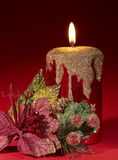 Christmas candle and poinsettia. Royalty Free Stock Photo