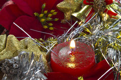 Christmas candle with poinsettia Stock Images