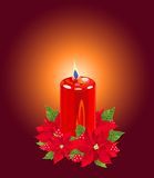 Christmas Candle with Poinsettias Royalty Free Stock Photos