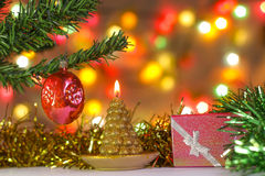 Christmas candle and present Stock Photography