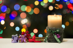 Christmas Candle and Presents Decorations On Blured Holiday Background. For Your Christmas Card Or Poster Stock Photos