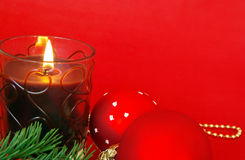 Christmas candle on red Royalty Free Stock Images