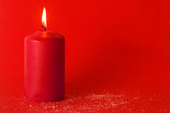 Christmas candle on red background Royalty Free Stock Photography