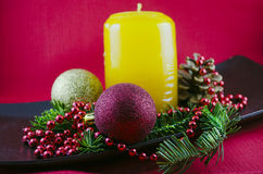 Christmas candle. On a red background stock image