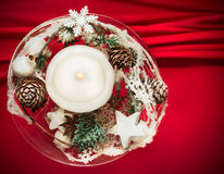 Christmas candle on red background Stock Images