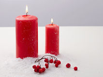 Christmas candle and red berries on snow Stock Photography