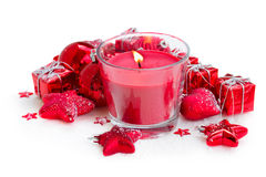 Christmas candle with red decorations Royalty Free Stock Photos