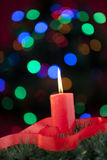 Christmas candle with red ribbon Stock Photography