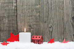 Christmas candle and red stars Stock Photos