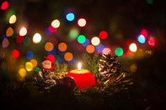Christmas candle and Santa Clouse Royalty Free Stock Image