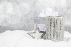 Christmas candle on snow Stock Photos