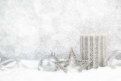 Christmas candle on snow Stock Images