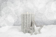 Christmas candle on snow Royalty Free Stock Image