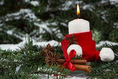 Christmas candle and spices Royalty Free Stock Photos