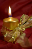 Christmas candle. This is christmas still life photo. It is a candle with a ribbon royalty free stock image