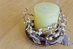 Christmas candle on the table. Beautiful large Christmas candle on a stand Stock Images