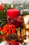 Christmas candle on a table Royalty Free Stock Photo