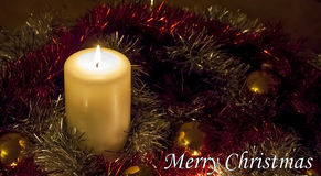 Christmas Candle and Tinsel - Merry Christmas!. Christmas Candle and Tinsel with text reading Merry Christmas royalty free stock photography