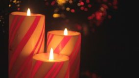 Christmas candle trio detail stock footage