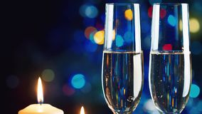 Christmas candle and two glasses of champagne. The celebration of christmas and new year stock video
