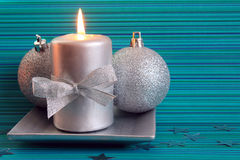 Christmas candle and two silver balls Royalty Free Stock Image
