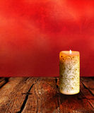 Christmas Candle on a Wooden Table Stock Photos