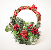 Christmas candle. Christmas wreath with red cones Royalty Free Stock Photo