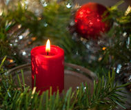 Christmas candle with a wreath and red ornament Royalty Free Stock Photo