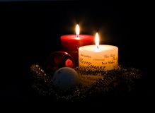 Christmas Candles. And ornaments on black Stock Images