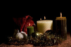 Christmas Candles. Tinsel and different candles, lit during Christmas stock image