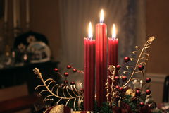 Christmas Candles. Three candles in a table setting for Christmas dinner Stock Photos