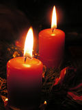 Christmas candles. In the dark on the desk Royalty Free Stock Photo