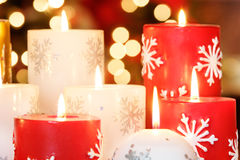 Christmas candles. Collection of Christmas candles with blurred light background stock photo